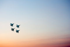 Jet fighters at the airshow moving upward. In sunset sky Royalty Free Stock Images
