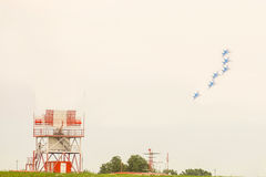 Jet fighters on a turn flies over an airfield with locators Royalty Free Stock Photo