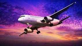 Jet in flight at sunset time Royalty Free Stock Photos