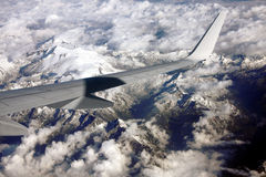 Jet flying above alps. Jet flying above snowy swiss alps Royalty Free Stock Photography