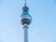 Jet Flying Past Fernsehturm TV Tower in Berlin Royalty Free Stock Images