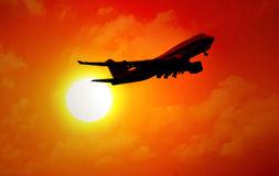 Jet flying in sunset Royalty Free Stock Photo