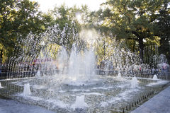 Jet fountain in the rays of the autumn sun Royalty Free Stock Images