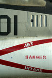 Jet intake military aircraft detail. Danger stenciled onto side of jet intake in red letters stock images