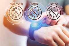 Jet lag concept with different hour time over a smartwatch Stock Photography