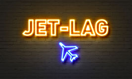 Jet-lag neon sign on brick wall background. Royalty Free Stock Image