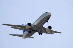 JET LANDING. An huge jet is landig with all its gear off royalty free stock image