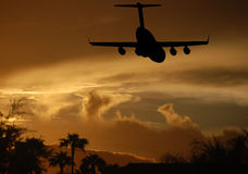 Jet landing at sunset Stock Image