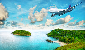 Jet liner over the tropical island Royalty Free Stock Image
