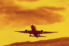 Jet Liner Takeoff In Sunset Light Royalty Free Stock Image