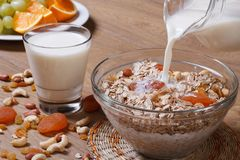 Jet milk pouring onto cereal Royalty Free Stock Photography