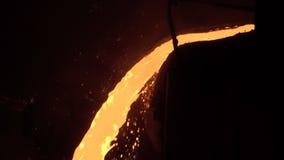 Jet of molten metal stock footage