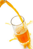 Jet Of Cold Orange Juice Stock Image