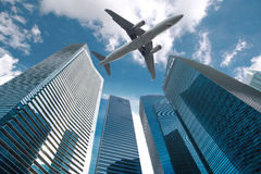 Jet over City. Looking up city building,Aircraft flying over from scratch on top stock images