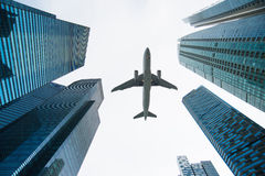 Jet over City. Looking up city building,Aircraft flying over from scratch on top stock photography
