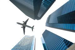 Jet over City. Looking up city building,Aircraft flying over from scratch on top royalty free stock photography