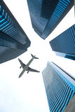 Jet over City. Looking up city building,Aircraft flying over from scratch on top royalty free stock photos