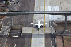 Jet over road and under bridge Stock Photos