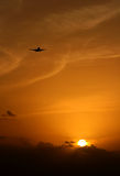Jet over sunset. A jet plane coming in for landing over the sunset stock photos