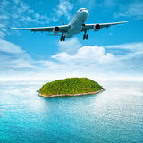 Jet over the tropical island Stock Photography