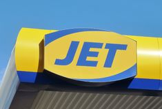 Jet Petrol Station Sign Logo. A Jet Petrol Station Sign Logo against a blue sky Royalty Free Stock Images
