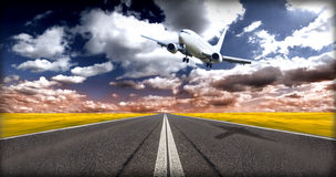 Jet plane above runway Royalty Free Stock Image