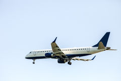 Jet Plane. A Jet Plane against a blue background Stock Image