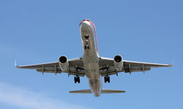 A Jet plane coming in for landing Stock Images