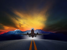 Jet plane flying over runways against rock mountain and beautifu Royalty Free Stock Photo
