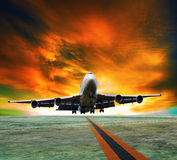 Jet plane flying over runways and beautiful dusky sky with copy Royalty Free Stock Photography