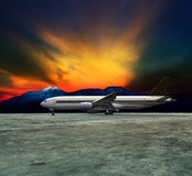 Jet plane flying over runways and beautiful dusky sky with copy Stock Photography