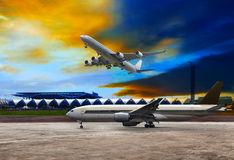 Jet plane flying over runways and beautiful dusky sky with copy Royalty Free Stock Image