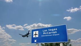 Airplane landing at Las Vegas McCarran Nevada. Jet plane landing in Las Vegas McCarran, Nevada, USA. City arrival with airport direction sign. Travel, business stock footage
