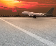 Jet plane landing on runway Stock Image