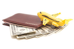 Jet plane and passport with dollars Royalty Free Stock Photography