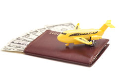 Jet plane and passport with dollars Stock Photo