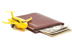 Jet plane and passport with dollars Stock Image