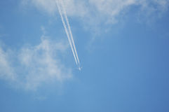 Jet plane in the sky. Jet plane in the blue sky Royalty Free Stock Images