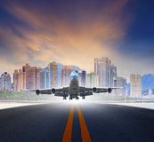 Jet plane take off from urban airport runways use for air transp Royalty Free Stock Photography