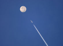 Jet plane to the moon. A jet plane seems to be flying towards the moon Royalty Free Stock Photo