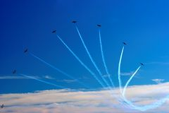 Jet Plane trail fan Royalty Free Stock Photography