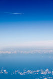 Jet Plane Vapor Trail Blue Sky White Clouds royalty free stock images