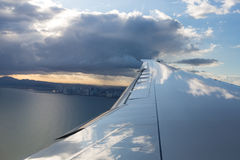 Jet plane wing with Panama City Royalty Free Stock Image