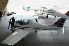 Jet Planes Maintenance. Wide angle shot of jet planes repair in maintenance hangar Royalty Free Stock Image