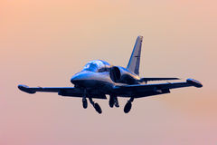 Jet propelled airplane. Approach landing strip at dawn Stock Photography