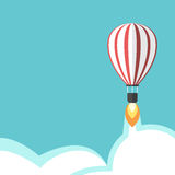 Jet propelled balloon. Jet propelled hot air balloon on turquoise blue sky background with flame, vapour and clouds. Creativity, start up and idea concept. Flat Royalty Free Stock Photo