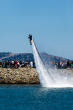 Jet propelled entertainer launches from the San Francisco Bay during celebrations for Louis Vuitton Cup in The Americas Cup Series. In Aug 2012 Royalty Free Stock Images
