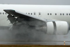 Jet Reverse Thurst. Jet landing at runway with raining. What's powerful engine is Stock Photo