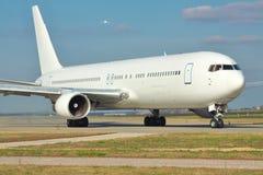 Jet on runway Stock Photography