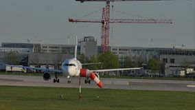 Plane staying in Munich Airport, MUC, spring. Jet on runway in Munich Airport, MUC, spring stock video